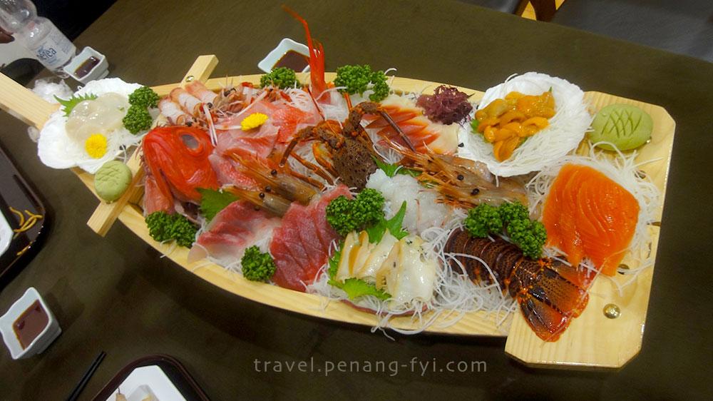 Luxurious dinner - sashimi boat....